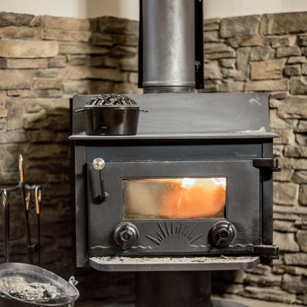 Wood burning stove cleaning window